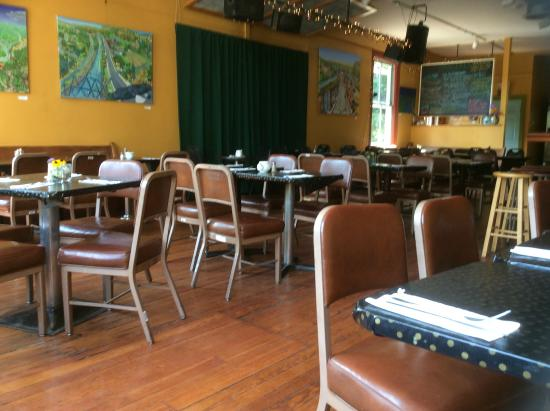 Seating at the Rosendale cafe includes a warm interior atmosphere, a bar with microbrews and wine, and garden seating in nicer weather.